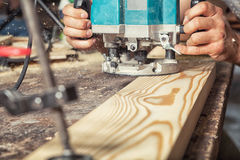 Wooden board with a green milling machine Stock Images
