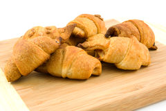 Wooden board with home made croissants Royalty Free Stock Image