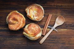 Wooden Board with Homemade Cinnamon Pastry Bakery Rols. Top View. Close up. Royalty Free Stock Images