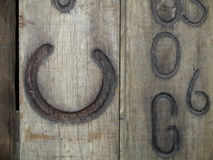 Wooden board with horseshoe branded Royalty Free Stock Photo