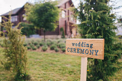 Wooden board with the inscription Wedding ceremony, wedding decorations . Stock Image