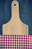 Wooden board and kitchen towel Stock Photos
