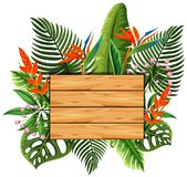 Wooden board with leaves and flowers in background Stock Photos