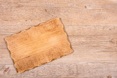 Wooden board for light meal on a table Royalty Free Stock Photo