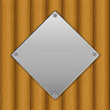 Wooden board and metal plate. Metal plate on wooden board background Stock Photos