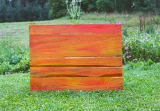Wooden board outdoors. Natural wood background. Wooden board outdoors. Natural wood background on green grass Royalty Free Stock Photography