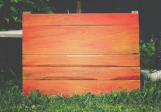 Wooden board outdoors. Natural wood background. Wooden board outdoors. Natural wood background on green grass outdoors Royalty Free Stock Photos
