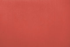 Wooden board painted red. Wood grain pattern showing through Royalty Free Stock Image