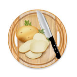 Wooden board with patato and knife Stock Photos