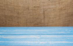 Wooden board plank table and burlap hessian sacking. Background, table in front view stock photo