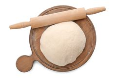 Wooden board with raw dough and rolling pin. On white background Royalty Free Stock Image