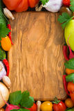 Wooden board for recipe and fresh vegetables, top view, close-up Royalty Free Stock Photos