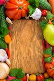 Wooden board for recipe and fresh vegetables, top view Stock Images