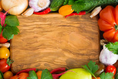 Wooden board for recipe, spices and fresh vegetables Royalty Free Stock Photos