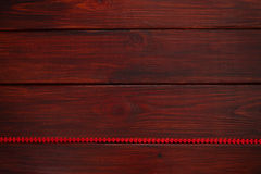 Wooden board with red heart ribbon Royalty Free Stock Images