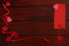 Wooden board with red heart ribbon and tag Stock Photo