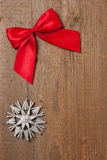 Wooden board with ribbon and star Royalty Free Stock Photos