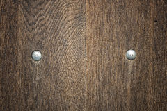 Wooden board with rivets Royalty Free Stock Photo
