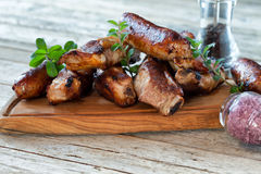Wooden Board With Roasted Spareribs And Sausages Stock Images