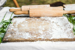 Wooden board and rolling-pin Royalty Free Stock Photos