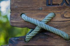 Wooden board and rope, background for design royalty free stock photos