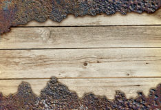 Wooden board among rusty metal Royalty Free Stock Photography