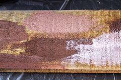 A wooden board with samples of different colors. Color matching. Experiments. Stock Photos