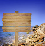 Wooden board on sea background. Wooden board on sea and  stone Stock Photos