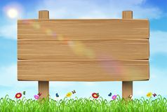 Wooden board sign on grass sky background. A wooden board sign on grass sky background Stock Photos