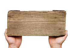 Wooden board sign on hand Royalty Free Stock Photography