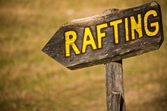Wooden board sign isolated for rafting showing direction spot on left Stock Image