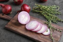 Wooden board with sliced red onion. On table, closeup Royalty Free Stock Photos