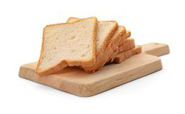 Wooden board with sliced toast bread. On white background royalty free stock images