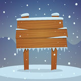 Wooden board in snow Royalty Free Stock Images