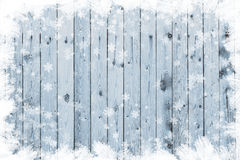 Wooden board with snow flakes. Copy space Stock Photo