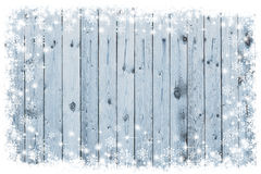Wooden board with snow flakes. Copy space Stock Photos