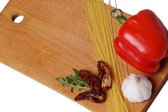 Italian cuisines. Wooden board with spaghetti, garlic and paper. Italian cuisine royalty free stock images