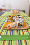 Wooden board with sushi. Wooden board with assorted sushi pieces Royalty Free Stock Image