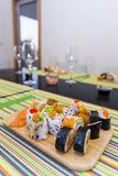 Wooden board with sushi Royalty Free Stock Photos