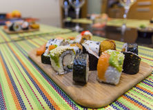 Wooden board with sushi. Wooden board with assorted sushi pieces Stock Photo