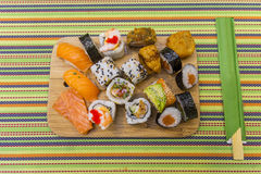 Wooden board with sushi Royalty Free Stock Photo