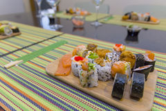 Wooden board with sushi Stock Image