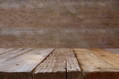 wooden board table in front of wooden background Stock Photo