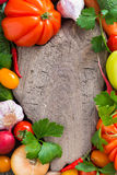 Wooden board for text, spices and fresh vegetables, top view Stock Photo