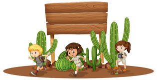 Wooden board with three kids in desert Stock Photography