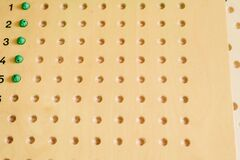 Wooden board to learn to count numbers and do mathematical operations