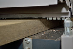 Wooden board is treated with planer Stock Photography