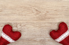 Wooden board with two read hearts Royalty Free Stock Image