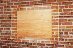 Wooden board under glass plate. Blank wooden board under glass plate on red brick wall background. Mock up, 3D Rendering Stock Image