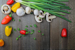 A wooden  board with vegetables. A wooden board with chopped and fresh vegetables Stock Photo
